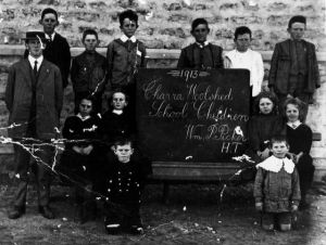 Chara School 1913: Pearl Denton (my mother) is on the right sitting next to the chalk board.