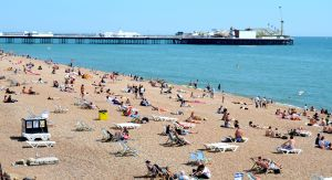 Brighton's pebbled beach and famous pier in the background.