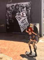 Love not war next to a shop selling bondage knick-nacks